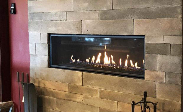 our portfolio gas fireplace with wood surround